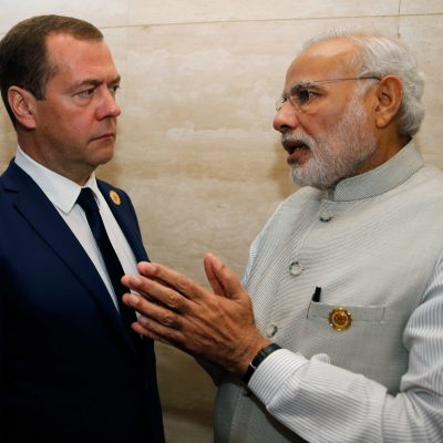 Russian Prime Minister Dmitry Medvedev, left, listens to Indian Prime Minister Narenda Modi, as they attend the 11th East Asia Summit at National Convention Center in Vientiane, Laos, Thursday, Sept. 8, 2016.(Dmitry Astakhov/ Sputnik, Government Press Service Pool photo via AP )