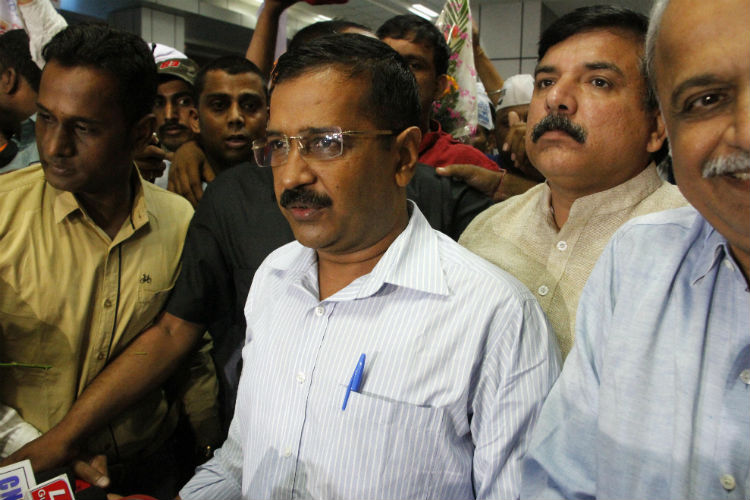 Pandemonium in Delhi Assembly: Kejriwal slams Modi, BJP MLA marshalled out