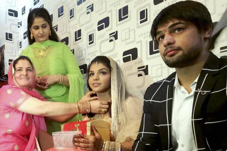 Who is Sakshi Malik's fiance SatyawartKadian?