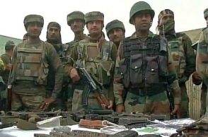 Indian Army jawans along with the arms seized from the terrorists in Handwara. (Photo: Twitter/ANI)