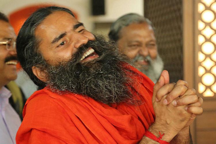 Baba Ramdev owned Patanjali Yogpeeth gets tax exemptstatus