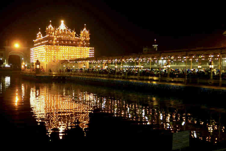 The Golden Temple is illuminated for Guru Nanak Jayanti. (Photo: PTI)