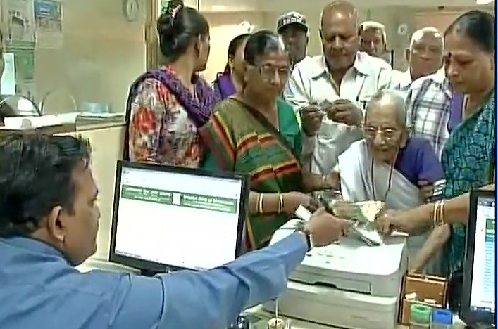 PM Narendra Modi's mother walks to bank to exchange notes