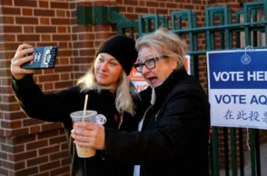 Two voters click a selfie outside a polling station in New york. (Photo: Reuters)