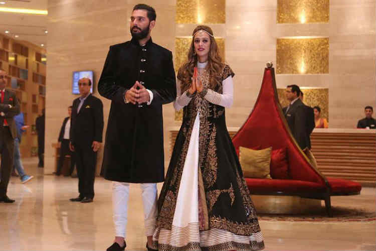 Yuvraj Singh and Hazel Keech greeting the guests in the lobby of the venue.