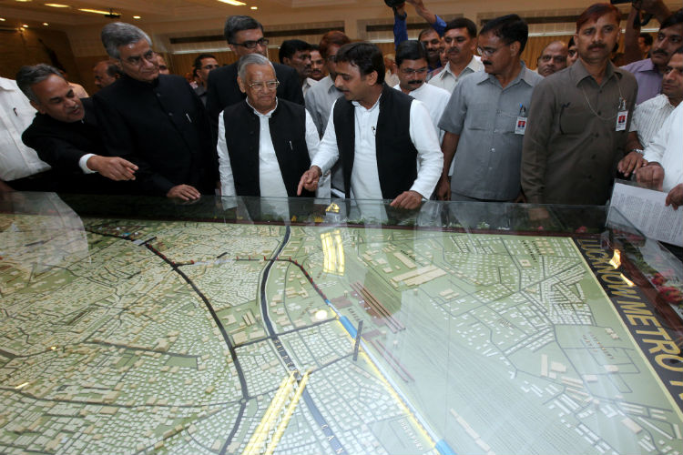 Akhilesh Yadav along with officials related with the Lucknow Metro Train having look of Lucknow Metro Train Route map