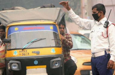 A traffic policeman wears a pollution mask due to smog and air pollution in Gurgaon on Wednesday following Diwali celebrations. (Photo: PTI)
