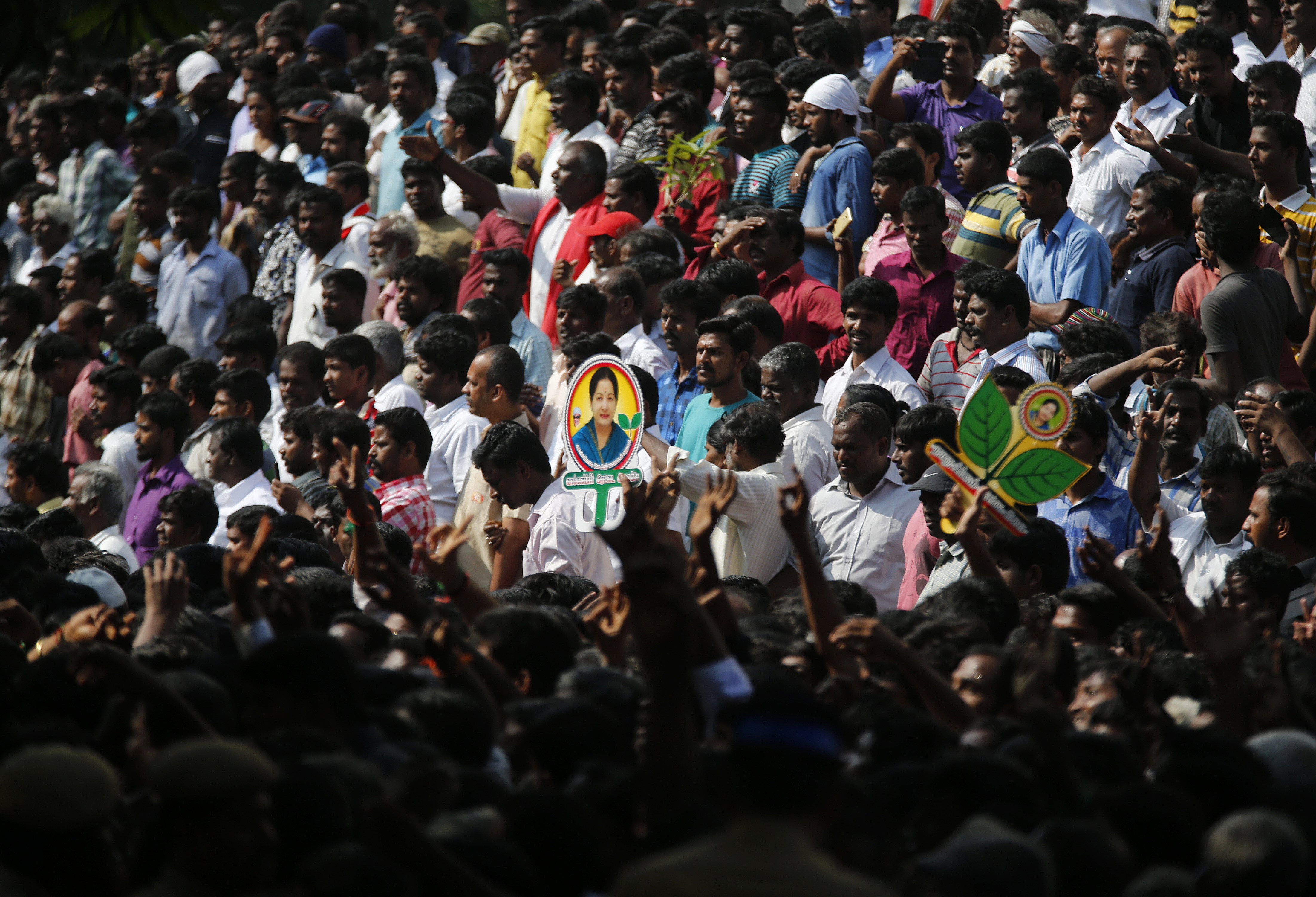Supporters of India's Tamil Nadu state's former Chief Minister, Jayaram Jayalalithaa, wait to see her body outside an auditorium in Chennai, India, Tuesday, Dec. 6, 2016. Jayalalithaa, the hugely popular south Indian actress who later turned to politics and became the highest elected official in the state of Tamil Nadu, died Monday. She was 68. (AP Photo/Aijaz Rahi)