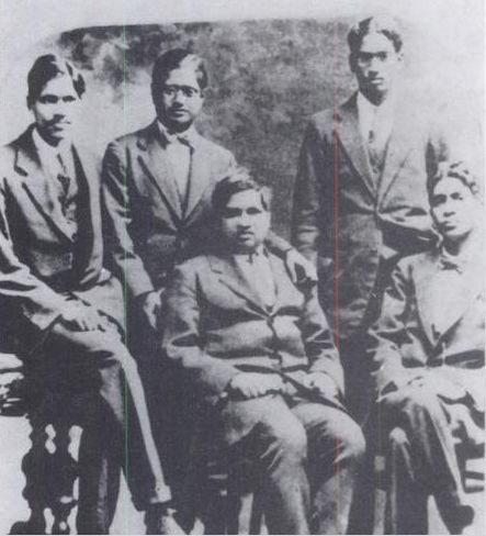Ramanujan (center) with Anand Rau (far-left)