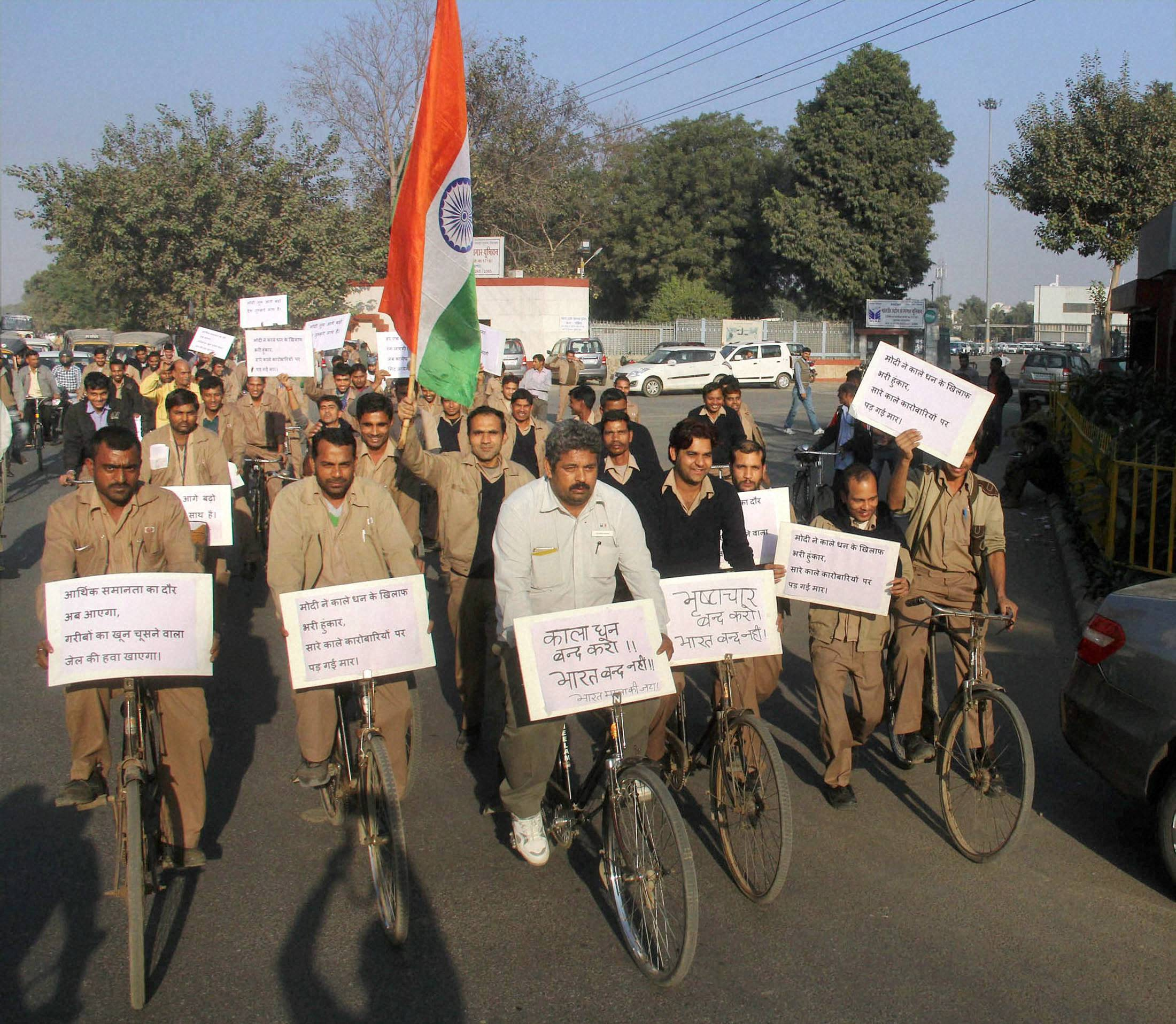 Gurugram : Workers of different unions including Maruti Udyog Kamgar Union arrange a support cycle procession for demonetisation in Gurugram. PTI Photo