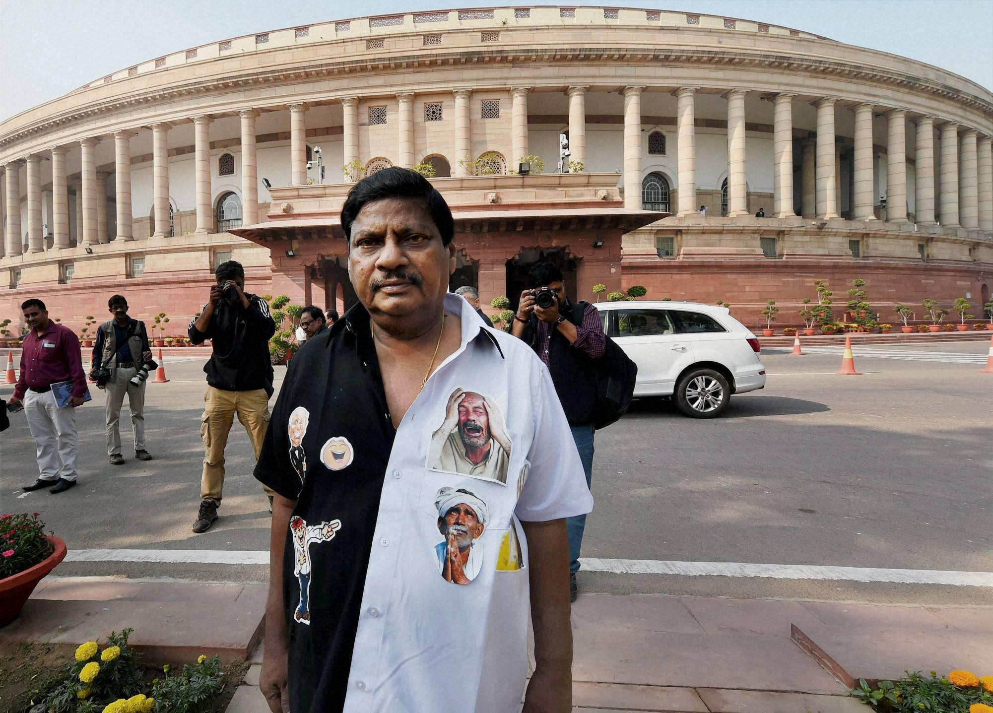 New Delhi: Telugu Desam Party MP N. Sivaprasad clad in a black-and-white attire to protest against demonetisation at the Parliament, in New Delhi on Tuesday. PTI Photo by Shahbaz Khan(PTI11_29_2016_000103B)