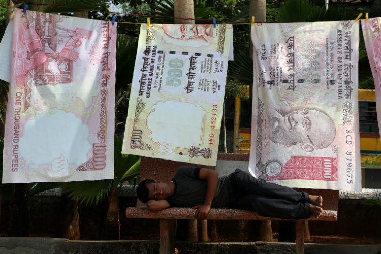 - Hung out to dry: A man catches a nap at alongside an installation artist's unique tea on the demonetisation of Rs 500 and Rs 1000 currency notes. The installation is part of a suburban art and culture festival in Bandra, Mumbai. Express photo by Prashant Nadkar