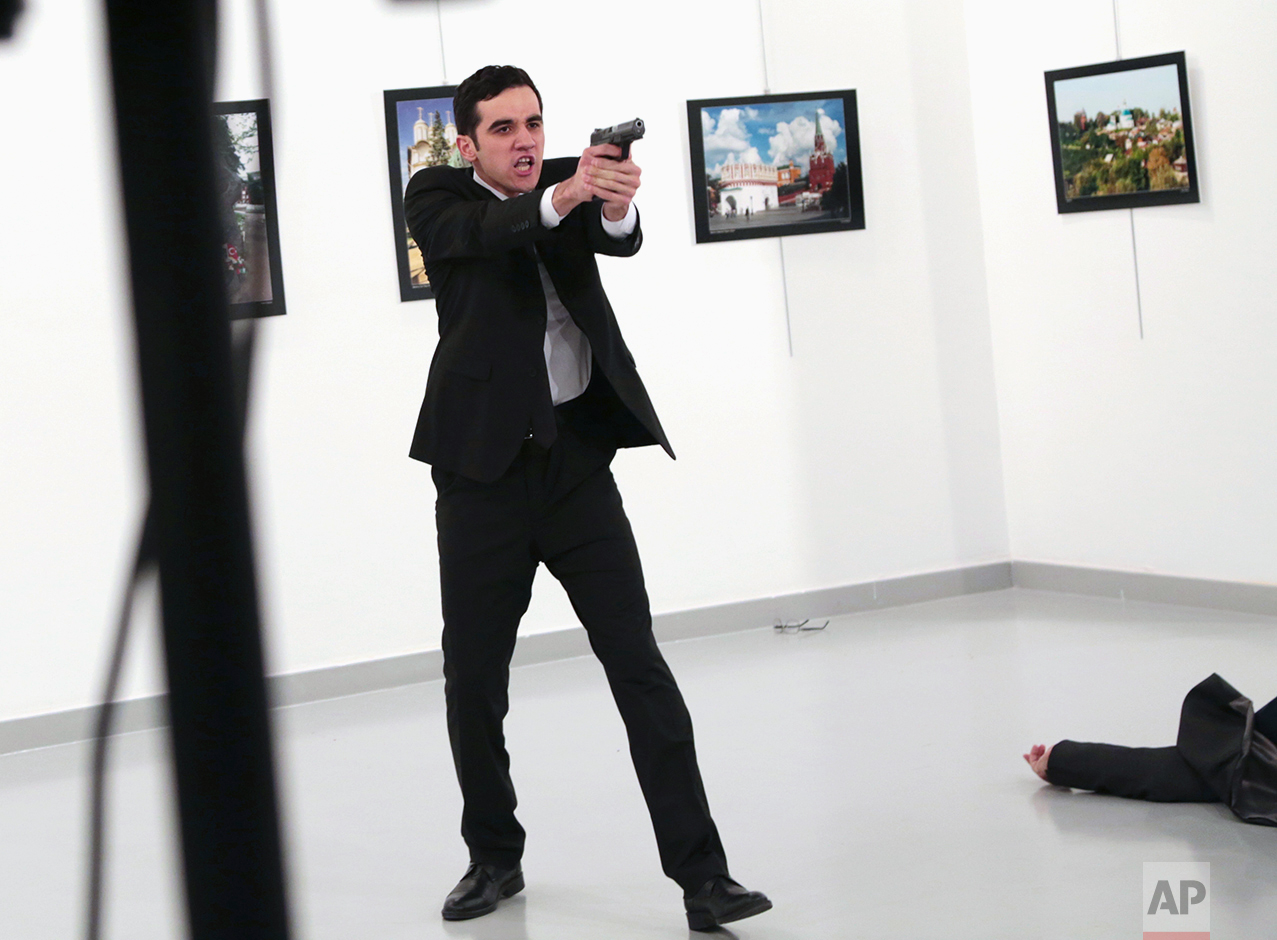 Gunman gestures after shooting the Russian Ambassador to Turkey (Photo: AP Photo/Burhan Ozbilici)