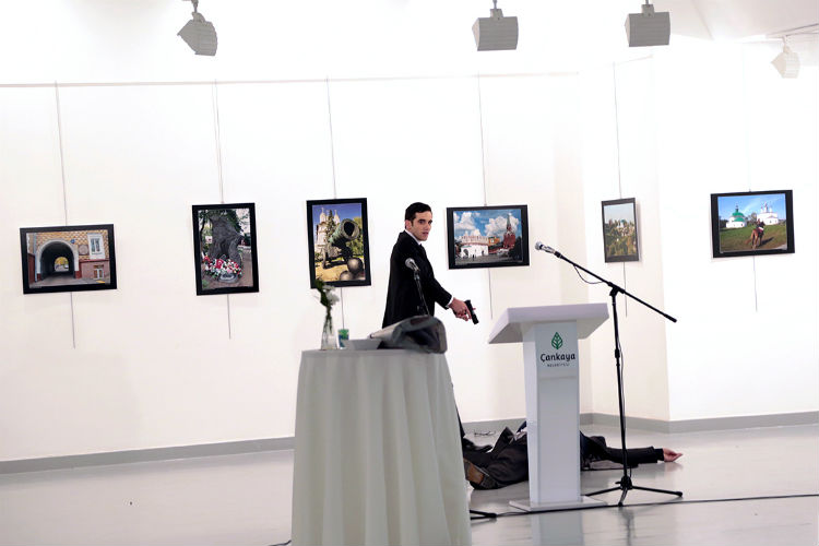 Man identified as Mevlut Mert Altintas shouts after shooting the Russian Ambassador to Turkey (Photo: AP Photo/Burhan Ozbilici)