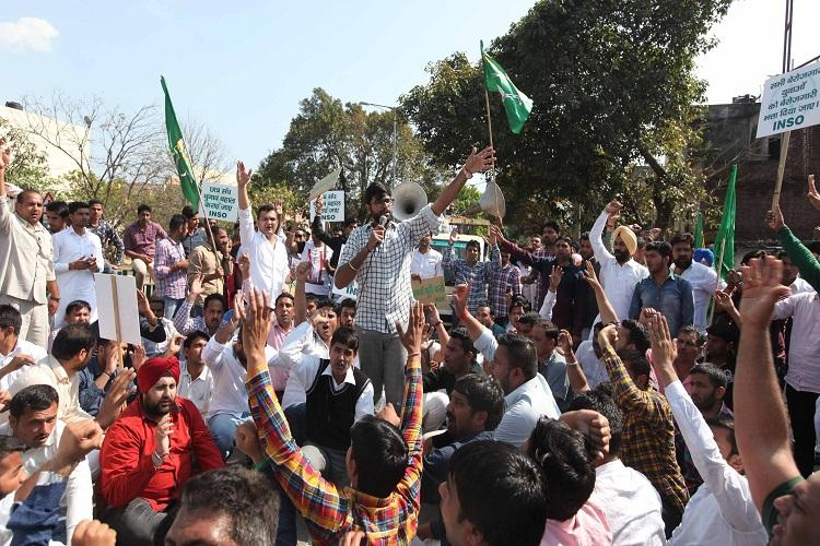 INLD leader Dushyant Chautala, Member of Parliament from Hisar Lok Sabha with his supporters protesting on the issue of Jat Reservation at Panchkula and Chandigarh border on Monday, March 14 2016. Express photo by Jaipal Singh