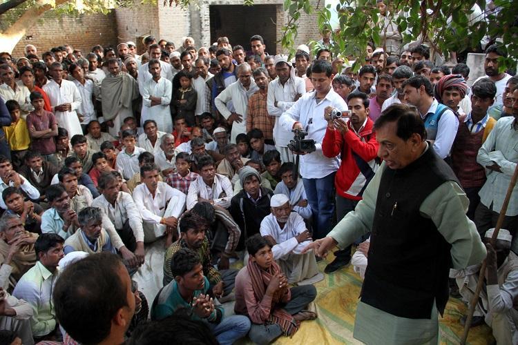 BJP Leader and Shamli MP Hukum singh reached Akbarpur village in Kairana where a man shot died on monday night. Express Photo by Gajendra Yadav. 22.11.2016.