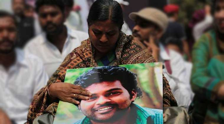 Rohith Vermula's mother holds his picture in a protest against suicide. (Photo: Indian Express)