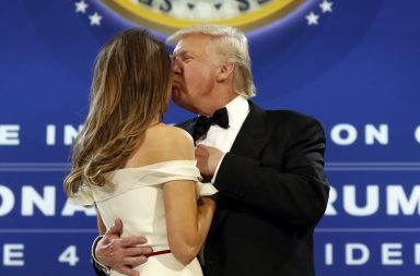 President Donald Trump kisses first lady Melania Trump as they dance at the The Salute To Our Armed Services Inaugural Ball in Washington, Friday, Jan. 20, 2017. (AP Photo/Alex Brandon)