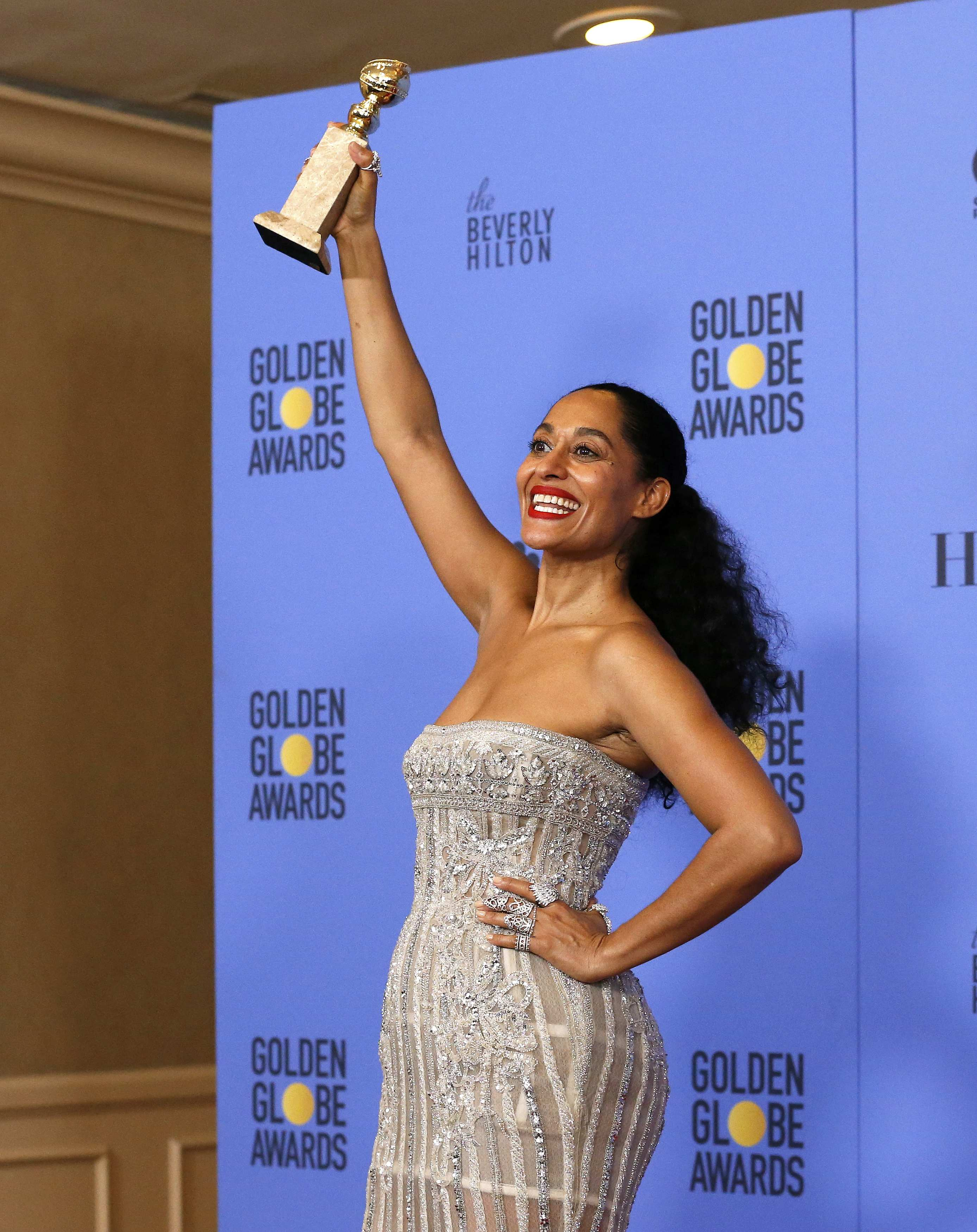"""Actress Tracee Ellis Ross holds the award for Best Performance by an Actress in a Television Series - Musical or Comedy for """"Black-ish"""" during the 74th Annual Golden Globe Awards in Beverly Hills, California, U.S., January 8, 2017. REUTERS/Mario Anzuoni"""
