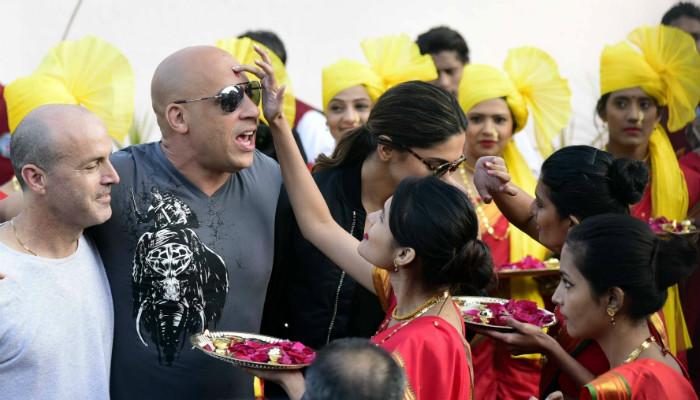 Vin Diesel (centre) and Deepika Padukone being greeted upon their arrival in Mumbai. (Photo: IANS)