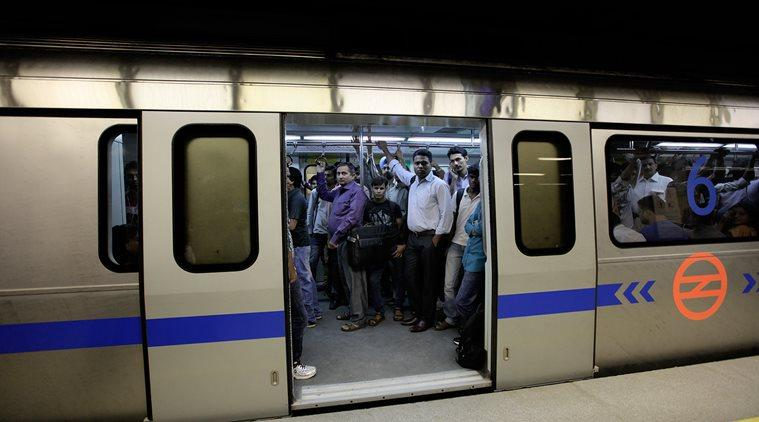 Commuters travel in a metro in New Delhi on June 26th 2014. The Phase III of the Delhi metro, the Mandi House to Central Secretariat, covers a distance of 3.2 kilometers (2 miles) is open to public on Thursday and is estimated to benefit 70,000 commuters. Express photo by Ravi Kanojia.