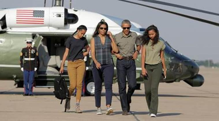U.S. President Barack Obama and U.S. First Lady Michelle Obama and their daughters Malia (L) and Sasha (R) walk to Air Force One as they depart from Roswell, New Mexico, U.S., June 17, 2016. REUTERS/Joshua Roberts TPX IMAGES OF THE DAY