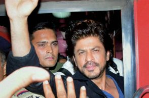 Shah Rukh Khan waves to fans from train