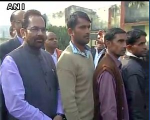 Union Minister Mukhtar Abbas Naqvi standing in queue to cast his vote (PIC ANI)