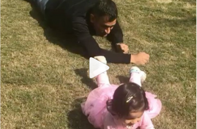 MS Dhoni having a dun moment with daughter Ziva, crawling with her in the garden. Photo Courtesy: MS Dhoni INstagram