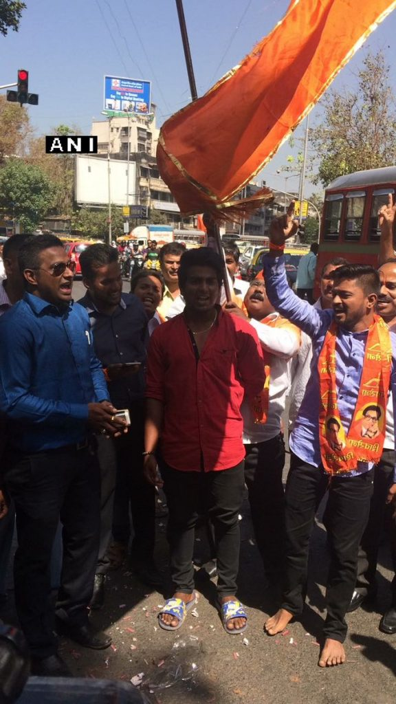Shiv Sena workers celebrating outside party office (PIC ANI)