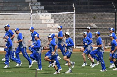 Australian players warm-up on Thursday before their tour match against India A
