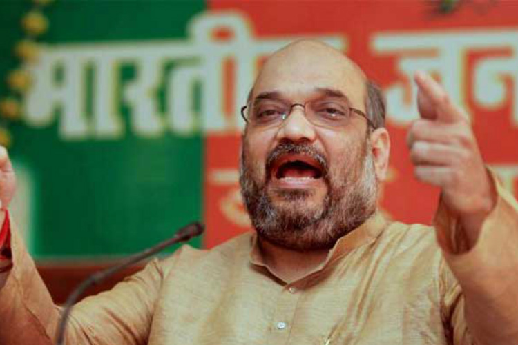 BJP President Amit Shah cited the example of Gujarat as he defended his party's decision to not award a single ticket to a Muslim candidate.