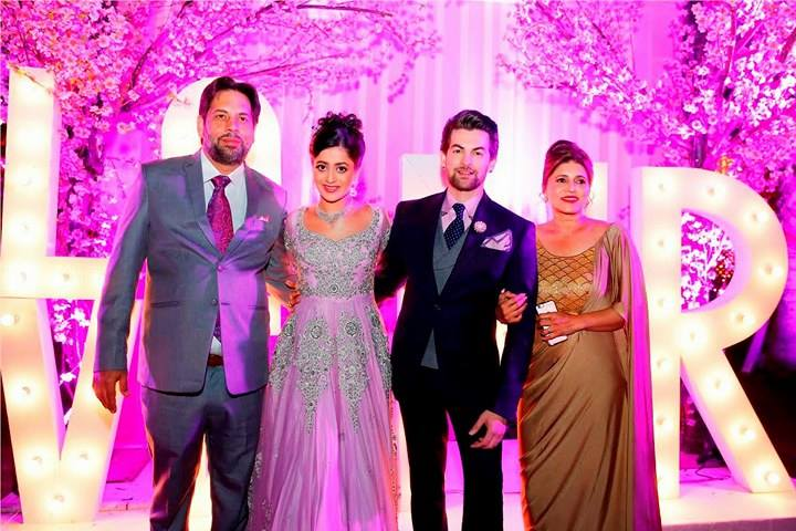 Neil Nitin Mukesh and Rukmini Sahay with family (Courtesy: The Wedding Story)