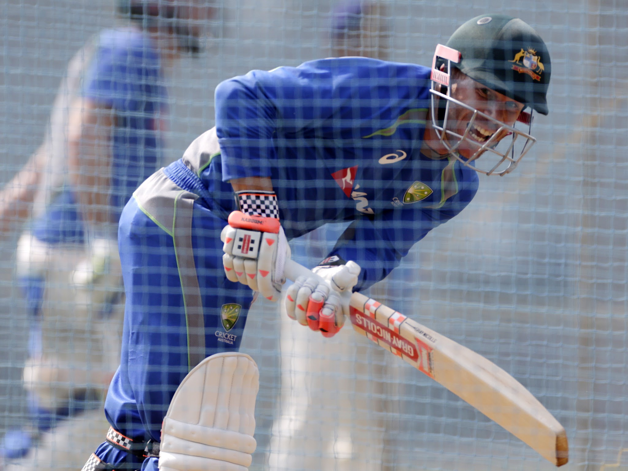 Australian cricketer David Warner bats during a practice session in Mumbai