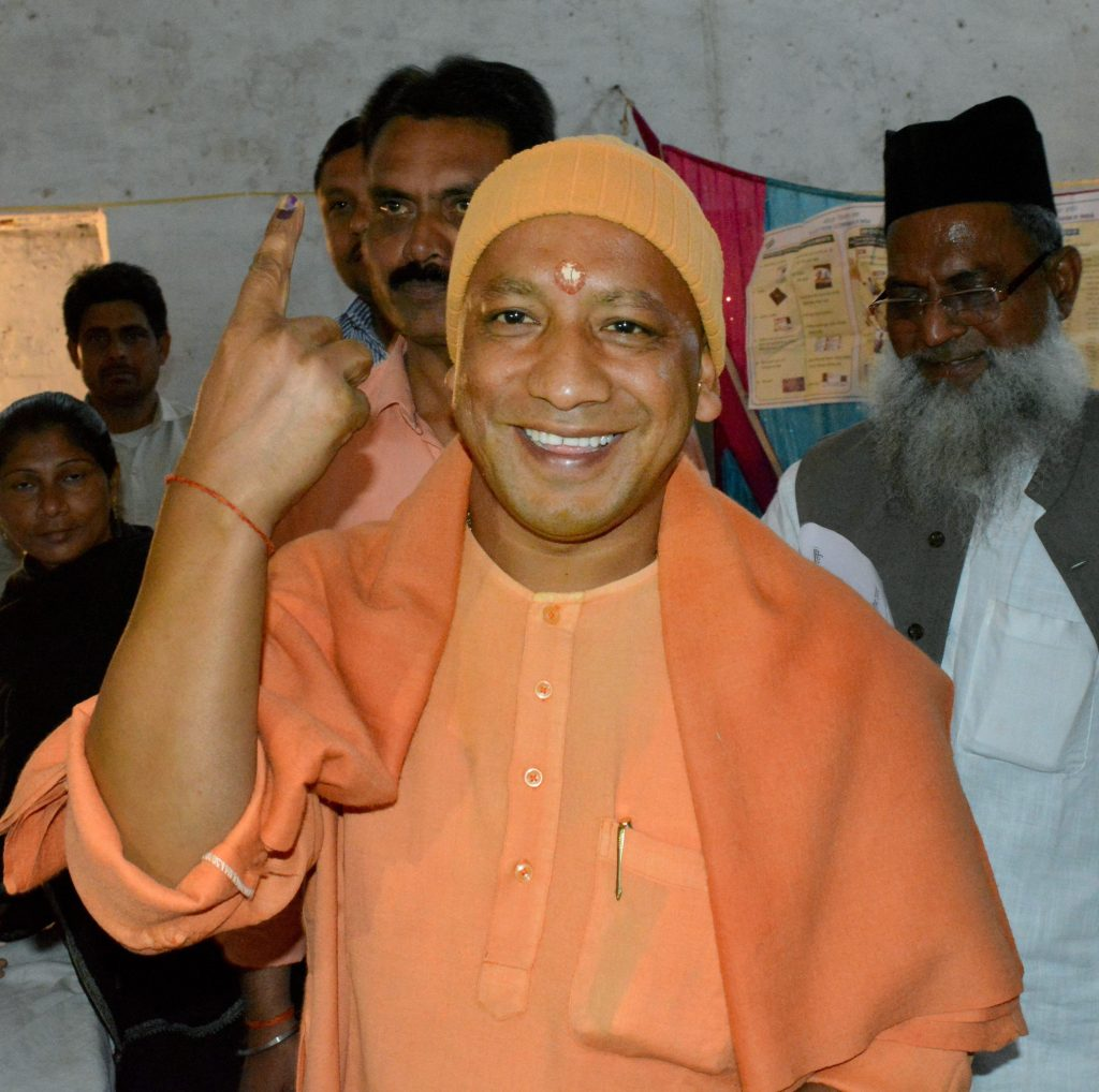Gorakhpur: BJP MP Yogi Adityanath at a polling station during the sixth phase of the state assembly election in Gorakhpur on Saturday. PTI Photo -(PTI3_4_2017_000231B)