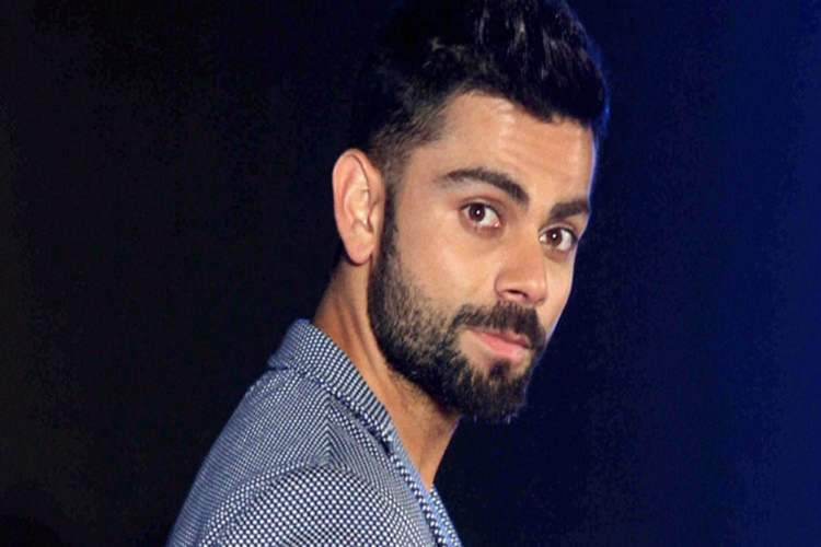 PIC: Virat Kohli has a SMILE after losing areview!