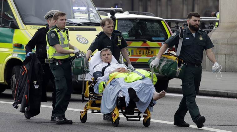 "Emergency services transport an injured person to an ambulance, close to the Houses of Parliament in London, Wednesday, March 22, 2017. London police say they are treating a gun and knife incident at Britain's Parliament ""as a terrorist incident until we know otherwise."" (AP Photo/Matt Dunham)"