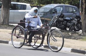 A handicapped person trying to protect himself from heat at Panjab University in Chandigarh