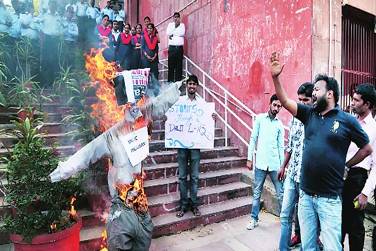Students protest massive cut in seats at JNU