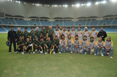 s-cricket-club-and-abu-dhabi-cricket-club-team-members-before-start-of-the-game-at-the-dubai-international-cricket-stadium