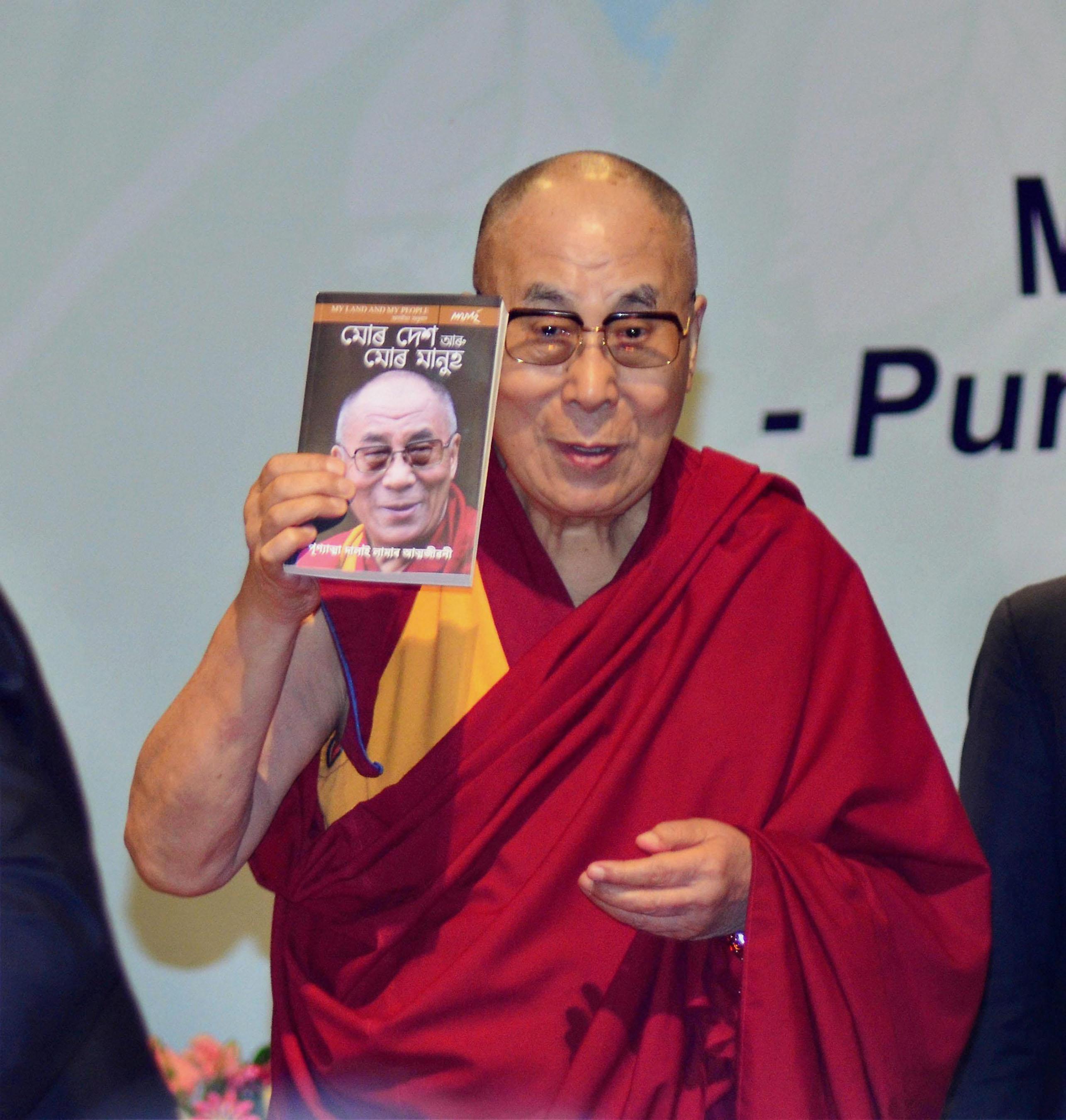 Guwahati: Tibetan spiritual leader Dalai Lama releasing Assamese translation his autobiography 'My Land and My People' as 'Mor Desh aru Mor Manuh' at Guwahati University in Guwahati on Sunday. PTI Photo(PTI4_2_2017_000037B)