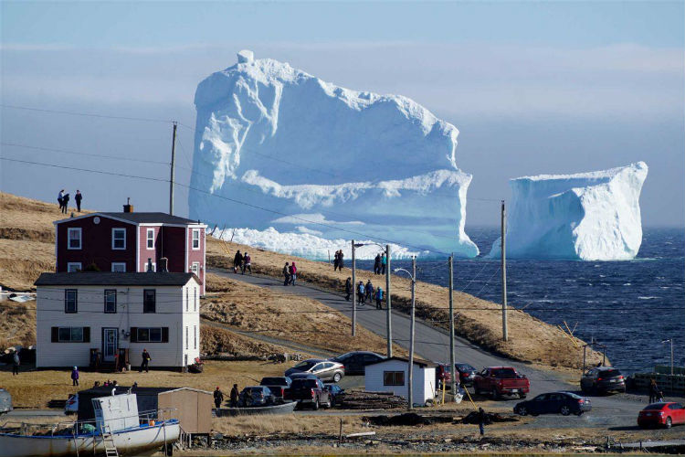 Photos: Gigantic iceberg casually floats into Canadian town, locals flock to take selfies