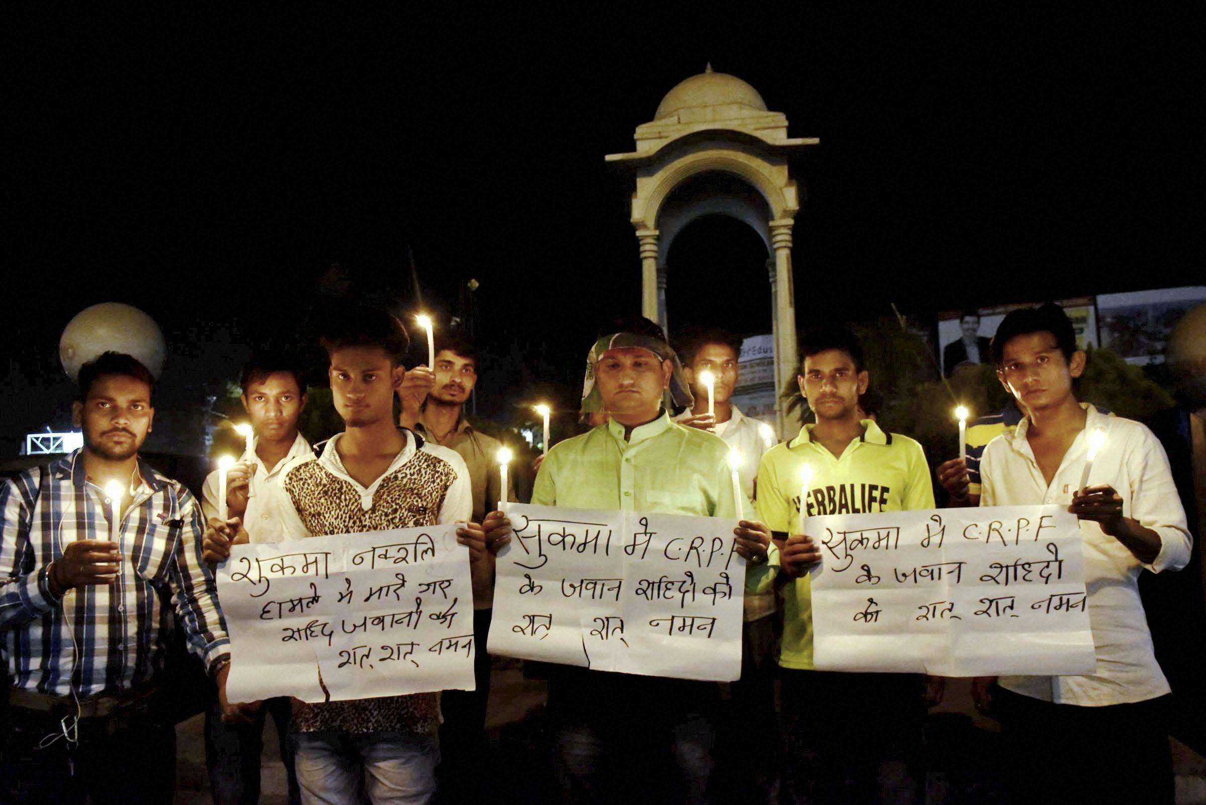 Patna: LJP activists take part in a candle light vigil to pray for CRPF jawans lost their lives in a Naxal attack in Chhattisgarh's Sukma district, in Patna on Monday. PTI Photo (PTI4_24_2017_000175B)