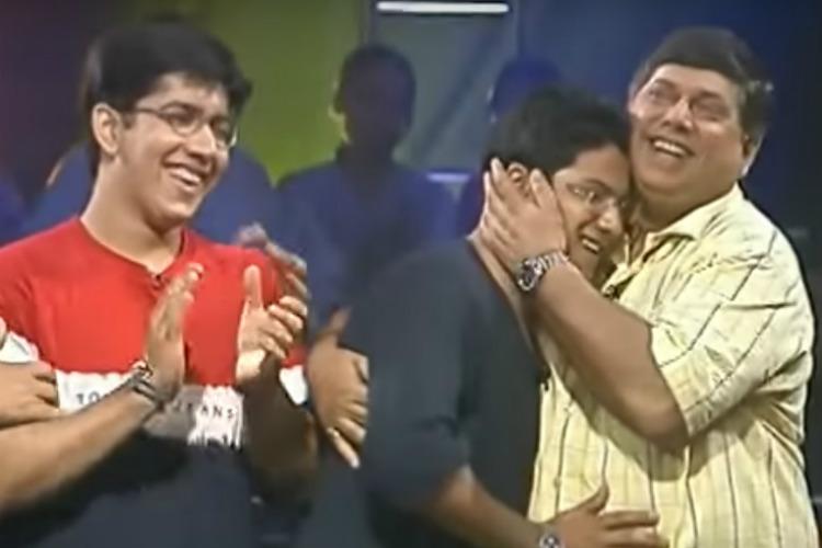 Varun Dhawan is hugged by father David Dhawan.
