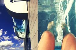 Watch: This swimming pool hangs 500 feet above the ground. Would you dare to dive in?