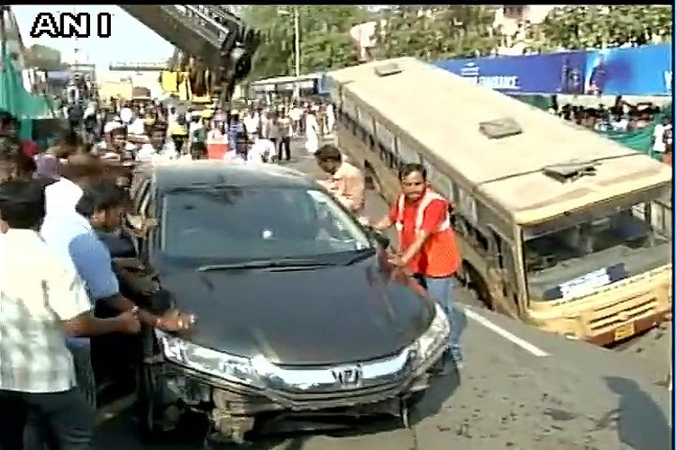 Road caves in at Chennai's prominent Anna Salai, takes bus and car along