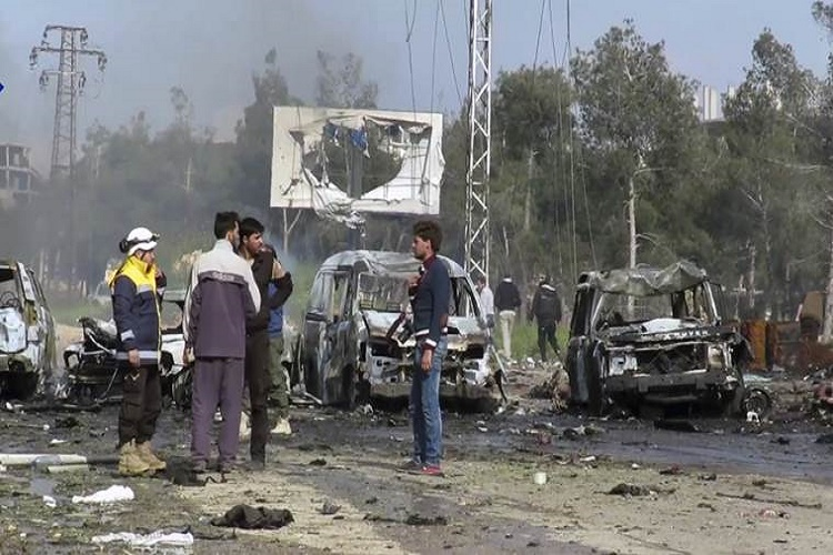 At least 100 killed in Syria as car bomb hits buses carryingevacuees