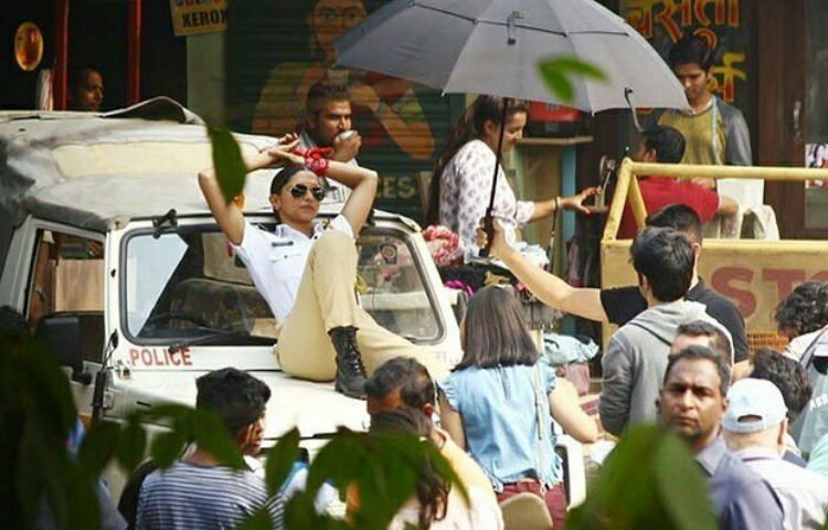 Deepika Padukone shooting for an ad while dressed like a cop