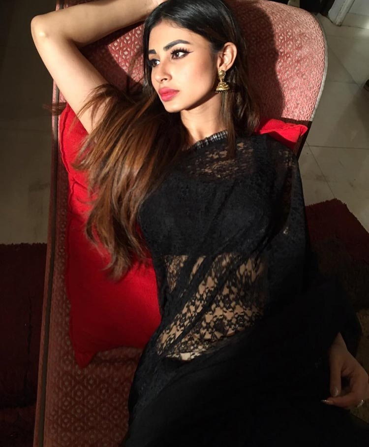 Mouni Roy looks like a sexy siren in her black saree