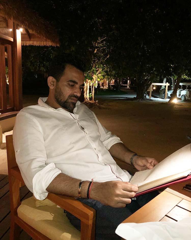 Zaheer Khan reading the menu for his Honeymoon dinner